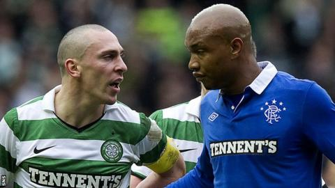 Celtic captain Scott Brown and Rangers' El Hadji Diouf