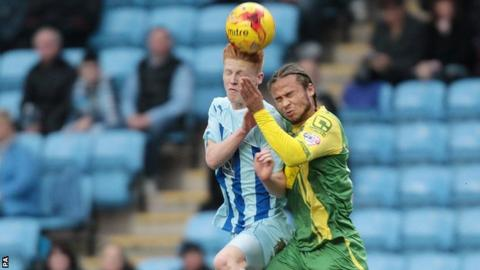 Curtis Thompson (right) challenges Coventry's Ryan Haynes