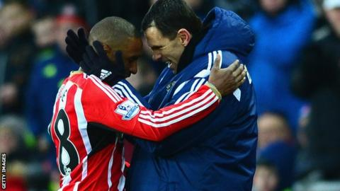 Jermain Defoe celebrates with Gus Poyet