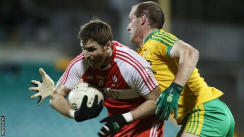 Donegal's Neil Gallagher challenges Derry's Gerard O'Kane at Ballybofey