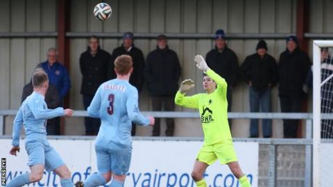 Saul Deeney is unable to stop Matthew Snoddy's lobbed goal in Saturday's game at Drumahoe