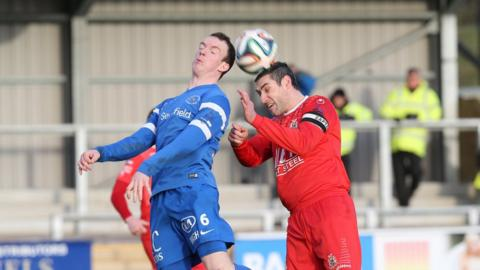 Ballinamallard's David Kee in aerial action against Portadown defender Keith O'Hara during the 0-0 stalemate