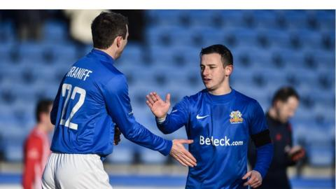 Kevin Braniff congratulates fellow Glenavon goalscorer after the latter scored an equaliser at Mourneview Park