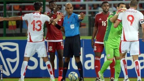 Referee Rajindraparsad Seechur tried to keep control of the Tunisia v Equatorial Guinea match