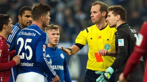 Klaas-Jan Huntelaar (number 25) is shown a red card