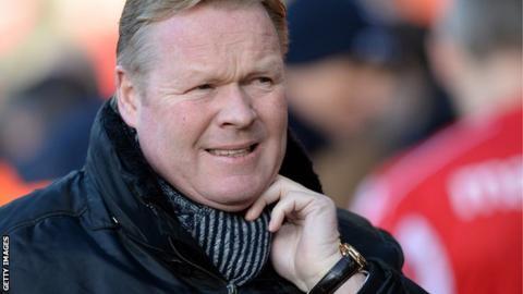 Ronald Koeman looks pensive as he watches a Southampton match