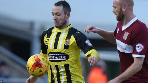 Oldham striker Rhys Murphy (left) playing for Dagenham