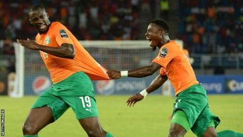 Yaya Toure and Serge Aurier celebrate the Ivory Coast's first goal against DR Congo