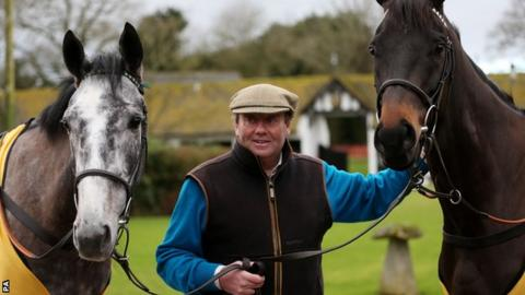 Nicky Henderson with Vasco Du Ronceray (left) and Sign Of A Victory