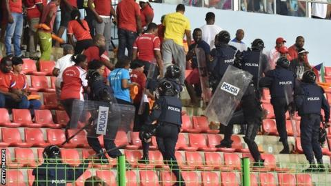 Police try to gain control of fans at the match between Ghana and Equatorial Guinea