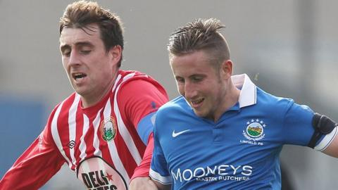 John Boyle of Warrenpoint in action against Linfield's Michael Carvill