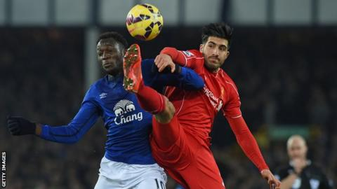 Everton forward Romelu Lukaku challenges with Liverpool's Emre Can