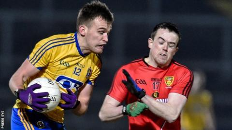 Roscomon's Enda Smith in possession against Conor Garvey of Down