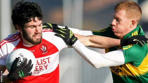 Derry's Daniel Heavron is challenged by Pa Kilkenny of Kerry at Celtic Park
