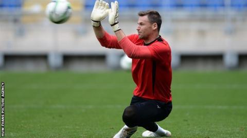 Cardiff City goalkeeper David Marshall has returned to training