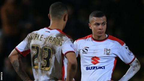 Jonson Clarke-Harris and Dele Alli of MK Dons