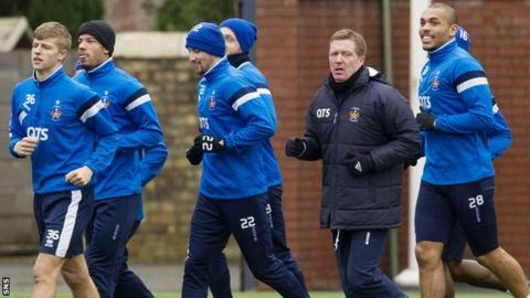 Kilmarnock manager Gary Locke with his players in training