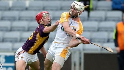 Neil McManus is challenged by Wexford's Lee Chin in last year's Leinster Championship game
