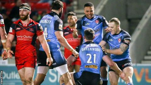 St Helens celebrate their try against Salford