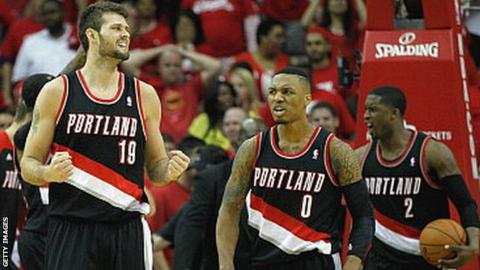 Portland Trail Blazers' Joel Freeland and Damian Lillard