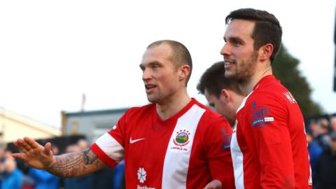 Linfield player-manager Warren Feeney with goalscorer Andrew Waterworth who scored in the 3-0 Premiership win over Dungannon Swifts