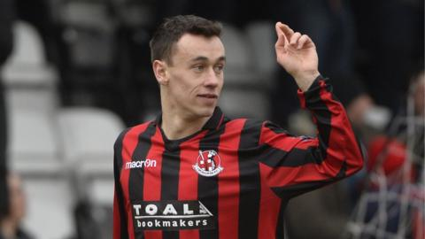 Winger Paul Heatley grabbed a double for Crusaders against Warrenpoint Town