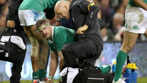 Jamie Heaslip receives treatment after suffering the injury to his lower back