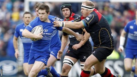 Leinster scrum-half Luke McGrath shrugs off the tackle of Brok Harris