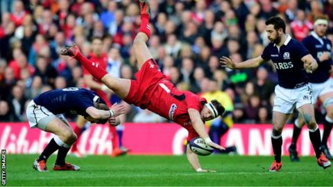 Dan Biggar is upended in a collision with opposite number Finn Russell