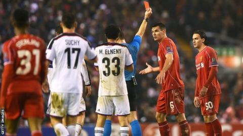 Lazar Markovic (right) shown the red card against Basel