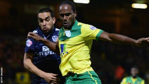 Cameron Jerome holds of Giuseppe Bellusci