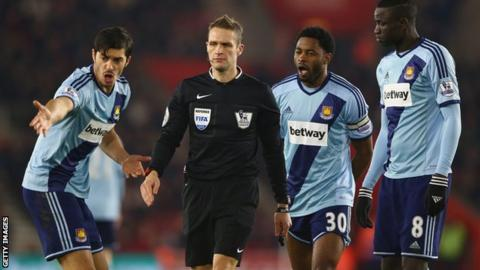 West Ham players protest to referee Craig Pawson