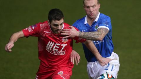Portadown's Chris Ramsey and Linfield player/manager Warren Feeney tussle for possession in Friday night's game Windsor Park