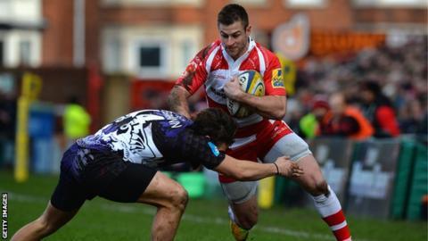 Henry Trinder tackled
