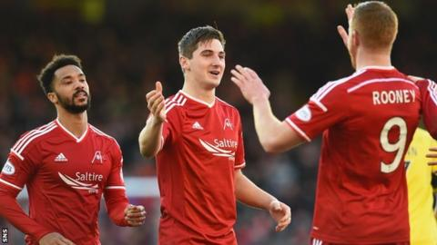 Kenny McLean (centre) set-up Adam Rooney's second goal