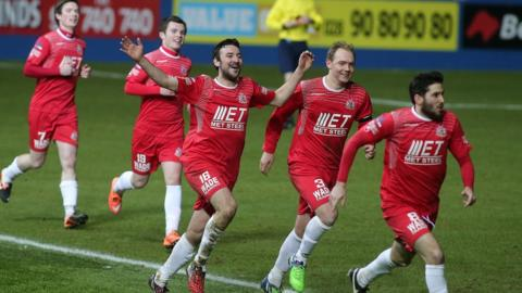 Portadown players chase Sean Mackle after his late winner in a 2-1 victory over the Blues