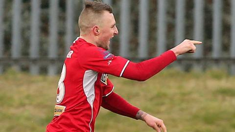 Reds midfielder Jay Donnelly runs to the bench to celebrate his goal which gave the champions a 1-0 win over Ballymena