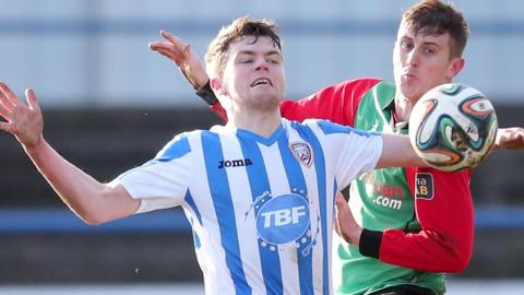 Coleraine's Shane McGinty shields the ball from Glens opponent Marcus Kane in Saturday's 1-1 draw