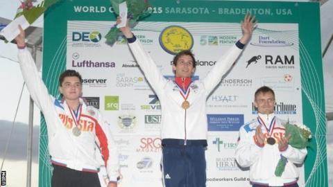 Britain's Jamie Cooke (centre) after winning gold at the Sarasota Modern Pentathlon World Cup