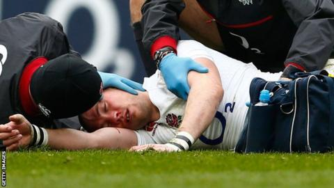 England full-back Mike Brown receives treatment for a head injury