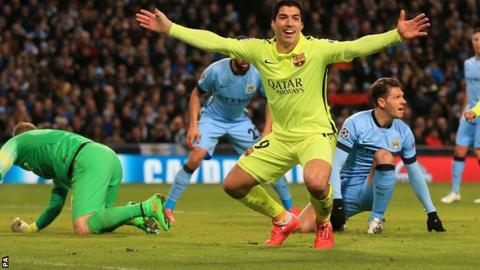 Luis Suarez celebrates scoring against Manchester City