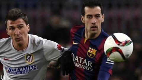 Barcelona midfielder Sergio Busquets (right)