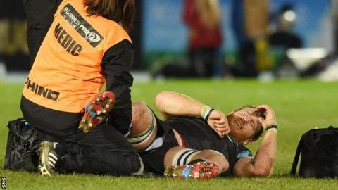 Tyrone Holmes is treated on the pitch during the win over Ospreys