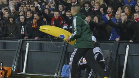 Fourth official carries an inflatable banana down the touchline