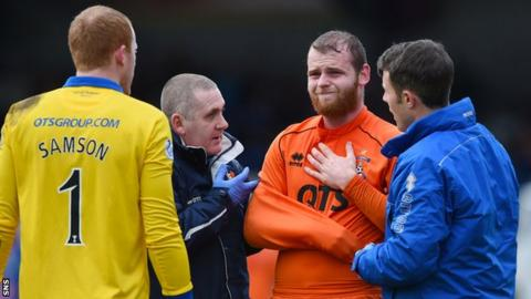 Mark Connolly looks in pain against Inverness
