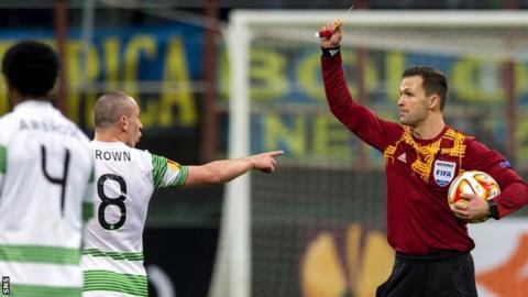 Celtic captain Scott Brown is booked by referee Ivan Kruzliakin