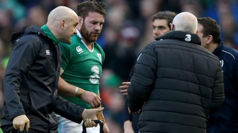 Sean O'Brien on his way off the Aviva Stadium field after suffering concussion