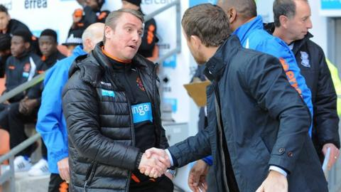 Blackpool boss Lee Clark shakes hands with his Gary Rowett, his successor as Birmingham City manager, prior to the Tangerines' 1-0 win at Bloomfield Road in December