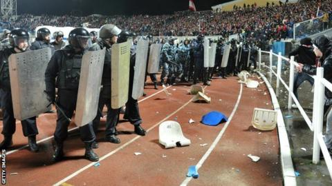 Russian riot police clash with fans during the Shinnik Yroslavl vs Spartak Moscow match in Yaroslavl on 30 October 2013
