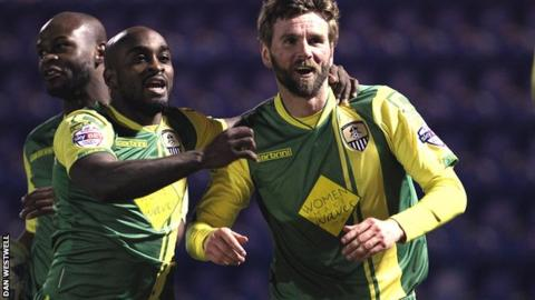 Paddy McCourt (r) celebrates his winner for Notts County